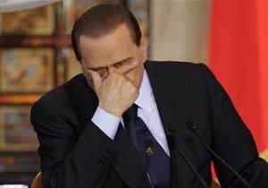 Берлускони предстанет перед судом по делу о связях с несовершеннолетней