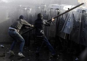 Фотогалерея: Традиционный погром. Массовые беспорядки в Белфасте во время марша оранжистов