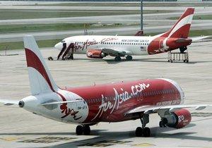 Это поможет нам заработать много денег: две малазийские авиакомпании обменялись акциями