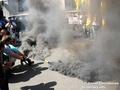 Участники акции протеста забросали Банковую дымовыми шашками