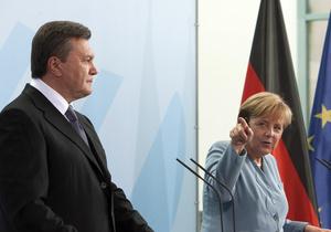 СМИ: Меркель обсудит с Януковичем в Варшаве дело Тимошенко