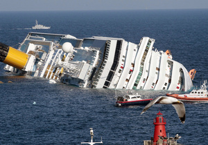 На затонувшем Costa Concordia обнаружили тело женщины. Число жертв возросло до 16