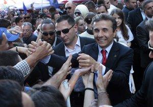 Выборы в Грузии: Оппозиционный блок увеличил отрыв от партии Саакашвили